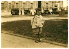 Lewis_Hine,_Ferris,_7_year_old_newsie,_Mobile,_Alabama,_1914